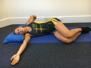 bow and arrow stretch for rowing injury